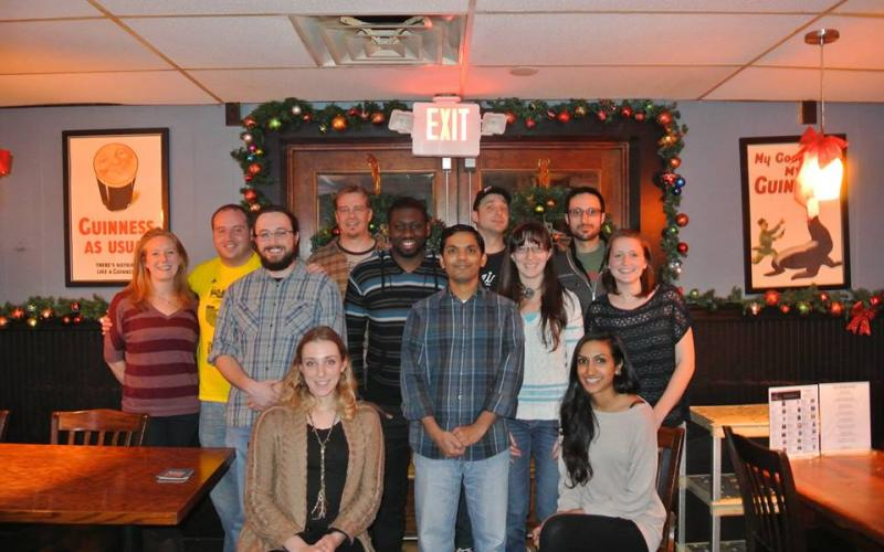 Former and current group members gather to celebrate the holidays in 2013.