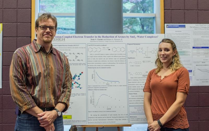 Tesia and Bob displaying recently published work at a University poster session.